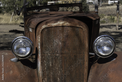 Closeup, front view of the rusted wreck of an old vehicle at Springsure, Queensland, Australia. - 222901691