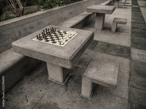 Chess Board And Pieces On Concrete Table And Benches In A Public Park In  San Francisco