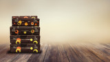Shabby Vintage Ancient Suitcases. Background of wooden boards. Travel Concept . - 222914011