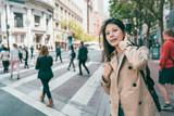 woman looking around the city joyfully