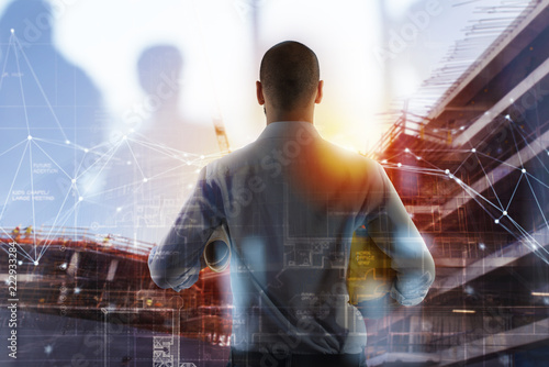 Foto Murales Businessman Architect analyzes the works of a building. double exposure