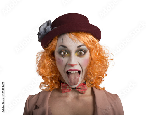 Leinwandbild Motiv Funny Grimace clown girl girl with tongue outside