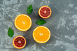 Oranges fruits composition with green leaves and slice on concrete background, top view - 222937692
