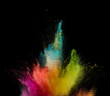 Colored powder explosion on black background. - 222937836