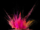 Colored powder explosion on black background. - 222937855
