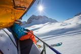 Skier sitting at ski lift. - 222939434