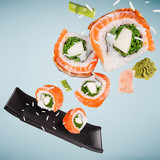 Pieces of delicious japanese sushi frozen in the air. - 222939443
