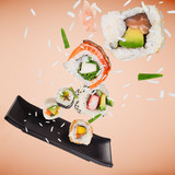 Pieces of delicious japanese sushi frozen in the air. - 222939472