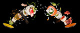 Pieces of delicious japanese sushi frozen in the air. - 222939668