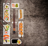 Traditional japanese sushi pieces on rustic concrete background. - 222940002