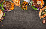 Top down view on traditional turkish meals on black stone table. - 222940089