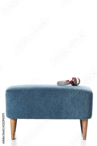headphones on blue chair isolated on white