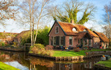 Scenic view on the canal in Giethoorn on a sunny  morning, Netherlands. - 222950602