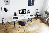 High angle view of a bright home office interior for a creative professional with black and white furniture and herringbone parquet floor. Real photo. - 222965066
