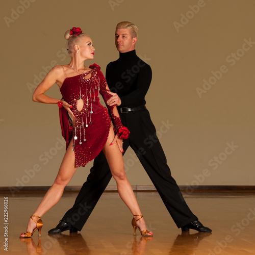latino dance couple in action  preforming a exhibition dance - wild samba - 222966026