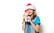 portrait of young teenage girl in Christmas hat with teddy bear on white background