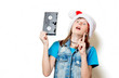 portrait of young teenage girl in Christmas hat with VHS on white background