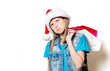 portrait of young teenage girl in Christmas hat with shopping bags on white background