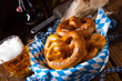Leinwanddruck Bild - real homemade bavarian salty pretzel with beer