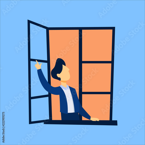 Man looking out of the opened window - 222989275