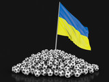 Soccer footballs with Ukrainian flag. Image with clipping path - 222993044