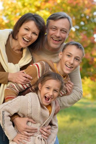 Leinwandbild Motiv Portrait of Happy family in autumn park