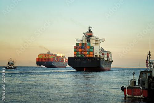 Leinwandbild Motiv Fully loaded container ships exiting the Los Angeles harbor