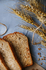 bread on wood background with millet top view