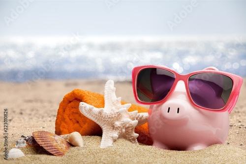 Summer piggy bank with sunglasses