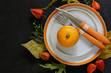 autumn table setting with pumpkin and flowers - 223011201