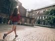 Woman walking at abandoned city