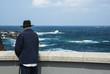 An elderly man on the oceanfront.