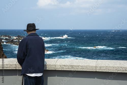 An elderly man on the oceanfront. - 223014819