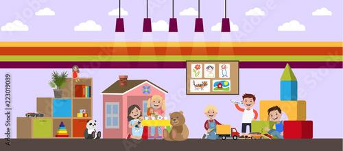 Children in kindergarten play with different toys - 223019089