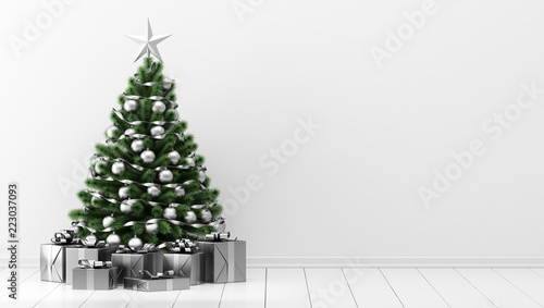 decorated christmas tree with gift boxes in white room - 223037093