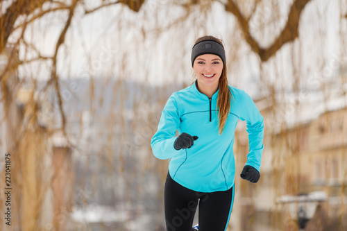 Winter sports, girl exercising in city