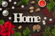 """Leinwandbild Motiv weihnachtliche Dekoration mit Wort """"Home"""" auf rustikalem Holzuntergrund"""