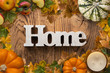 "Leinwanddruck Bild - word ""home"" on wooden background with autumn decoration"
