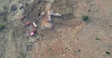 Third world rural shanty settlement with livestock in makeshift shelters aerial drone shot - 223089234
