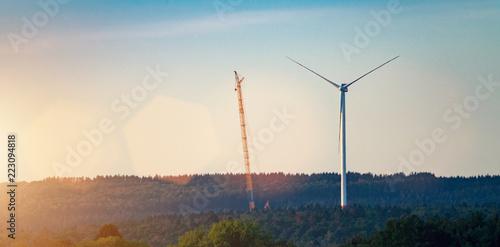 Leinwandbild Motiv Windmill at windfarm on a sunny summer day