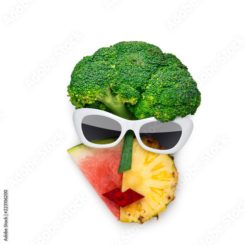 Tasty art / Creative concept photo of cubist style female face in sunglasses made of fruits and vegetables, on white background. - 223106200