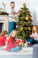 parents and kids spending time together on christmas at home