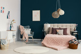 Three handmade lamps hanging above bed with soft bedhead in the real photo of white and blue bedroom interior - 223146690