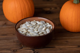 Pumpkina and seeds on wood - 223147007