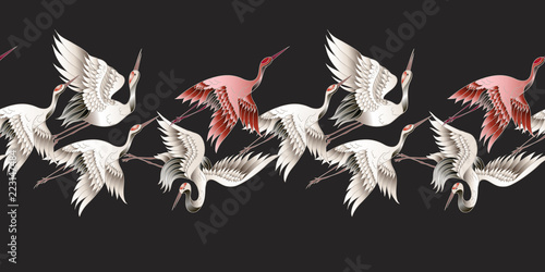 Seamless border with Japanese white crane in batik style. Vector illustration. © Yumeee