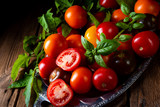 various types of tomatoes served and presented on the silver platter. - 223165064