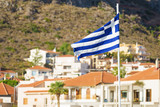 Greek flag against town - 223172423