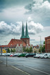Old church in Berlin. Germany. Beautiful cityscape, street, parking, cars. Ordinary city life.