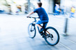 bicycle rider in the city in motion blur - 223187297