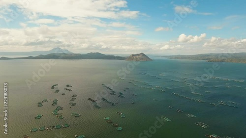 aerial footage Taal volcano on an island in middle lake. Luzon, Philippines Tropical landscape, mountains and volcano in the lake